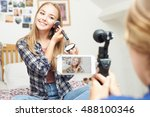 two teenage girls recording... | Shutterstock . vector #488100346