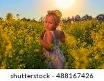 a little girl runs through a... | Shutterstock . vector #488167426