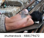 Homeless With Angel Tattoo On...