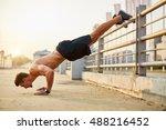 Sport Men Doing Push Ups Durin...