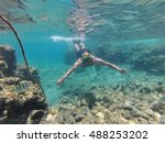 man is  diving underwater with... | Shutterstock . vector #488253202