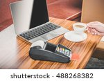 Small photo of Woman pay with credit card in cafe bar good background