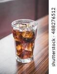 coke splashing from glass on... | Shutterstock . vector #488276512