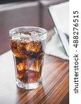 coke splashing from glass on... | Shutterstock . vector #488276515