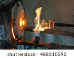 Stock photo blowing glass glass furnace image of a factory producing glass cup glass blowing in factory 488310292