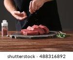 butcher cooking pork meat on... | Shutterstock . vector #488316892