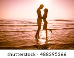 love   young couple holding to... | Shutterstock . vector #488395366