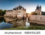 Chateau de Chenonceau at sunset, France. Castle located near the small village of Chenonceaux in Loire Valley and is a French landmark. Panoramic view of the old mansion on the River Cher in evening. - stock photo