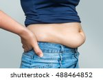 overweight woman in jeans and... | Shutterstock . vector #488464852