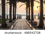 Small photo of JEDDAH, SAUDI ARABIA - OCTOBER 15, 2016. Saudi Arabian people walking by Jeddah Corniche near King Fahd's Fountain in sunset