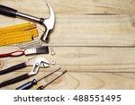 assorted work tools on wood.... | Shutterstock . vector #488551495