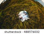 tired people slept on the meadow | Shutterstock . vector #488576032