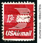 Small photo of UNITED STATES OF AMERICA - CIRCA 1960s: A used Air Mail postage stamp from the USA, depicting an illustration of an envelope with wings, circa 1960s.