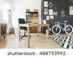 shot of a wooden desk in a... | Shutterstock . vector #488753992
