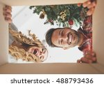 young couple opening a... | Shutterstock . vector #488793436