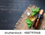 fresh mint essential oil on... | Shutterstock . vector #488795968