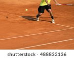 Male Tennis Player In Action O...