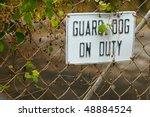 A Guard Dog On Duty Sign On A...