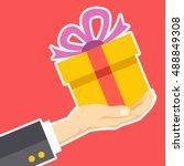 hand holding gift box.... | Shutterstock .eps vector #488849308