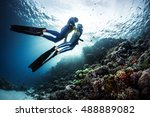 two freedivers swimming... | Shutterstock . vector #488889082