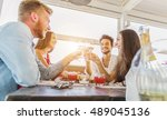 happy group of friends toasting ...   Shutterstock . vector #489045136