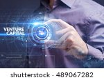 Small photo of Business, Technology, Internet and network concept. Young businessman working on a virtual screen of the future and sees the inscription: venture capital
