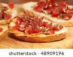 crispy italian bruschetta with basil, garlic and tomato - stock photo