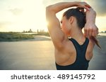 athletic woman warming up... | Shutterstock . vector #489145792
