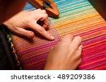 woman's hands on the color warp | Shutterstock . vector #489209386