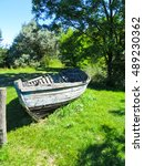 Old Wooden Boat On A Coast Of...
