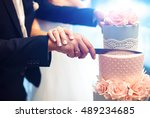 a bride and a groom is cutting... | Shutterstock . vector #489234685
