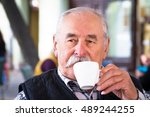elderly man with cup of coffee...   Shutterstock . vector #489244255