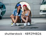 two young girls sitting on... | Shutterstock . vector #489294826