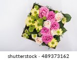 Gift Box With Flowers On White...