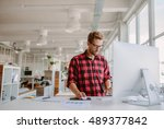 young man working on computer.... | Shutterstock . vector #489377842