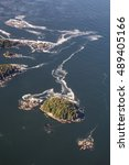 Small photo of Aerial photography of beautiful islands near the coast of Vancouver Island, British Columbia, Canada.
