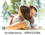 girlfriend cheating texting on... | Shutterstock . vector #489410386
