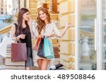 happy young women with shopping ... | Shutterstock . vector #489508846