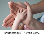 family shooting hands baby and... | Shutterstock . vector #489558292