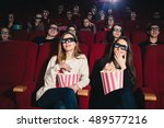 two friends in the cinema on... | Shutterstock . vector #489577216