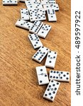 domino chips on wooden table. | Shutterstock . vector #489597922
