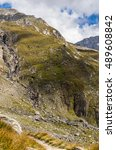 Small photo of Alpen Mountains with Blue Sky and Clouds, Road to Hochfeiler Hutte