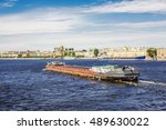 Small photo of SAINT-PETERSBURG, RUSSIA - JUNE 22, 2016: Self-propelled scow Nevsky-39 is on the Neva River in downtown of St. Petersburg