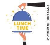 waiter hands opening cloche lid ...   Shutterstock .eps vector #489652216