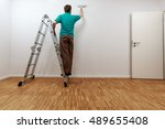 man on ladder while painting... | Shutterstock . vector #489655408
