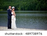 tall groom in dark blue suit... | Shutterstock . vector #489738976