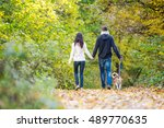young couple with dog on a walk ... | Shutterstock . vector #489770635