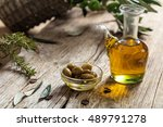 Olive Oil And Olive Twig On A...