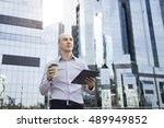businessman using cell tablet... | Shutterstock . vector #489949852