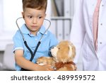 little doctor examining a  toy... | Shutterstock . vector #489959572